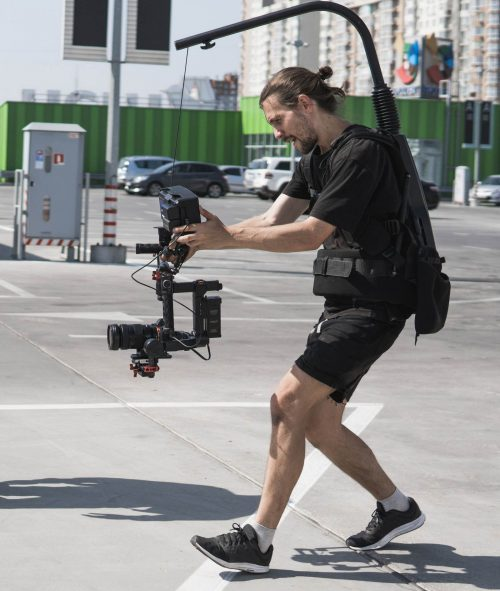 Image of our staff at Elite Video of Salt Lake City shoowing some footage out in a parking lot.